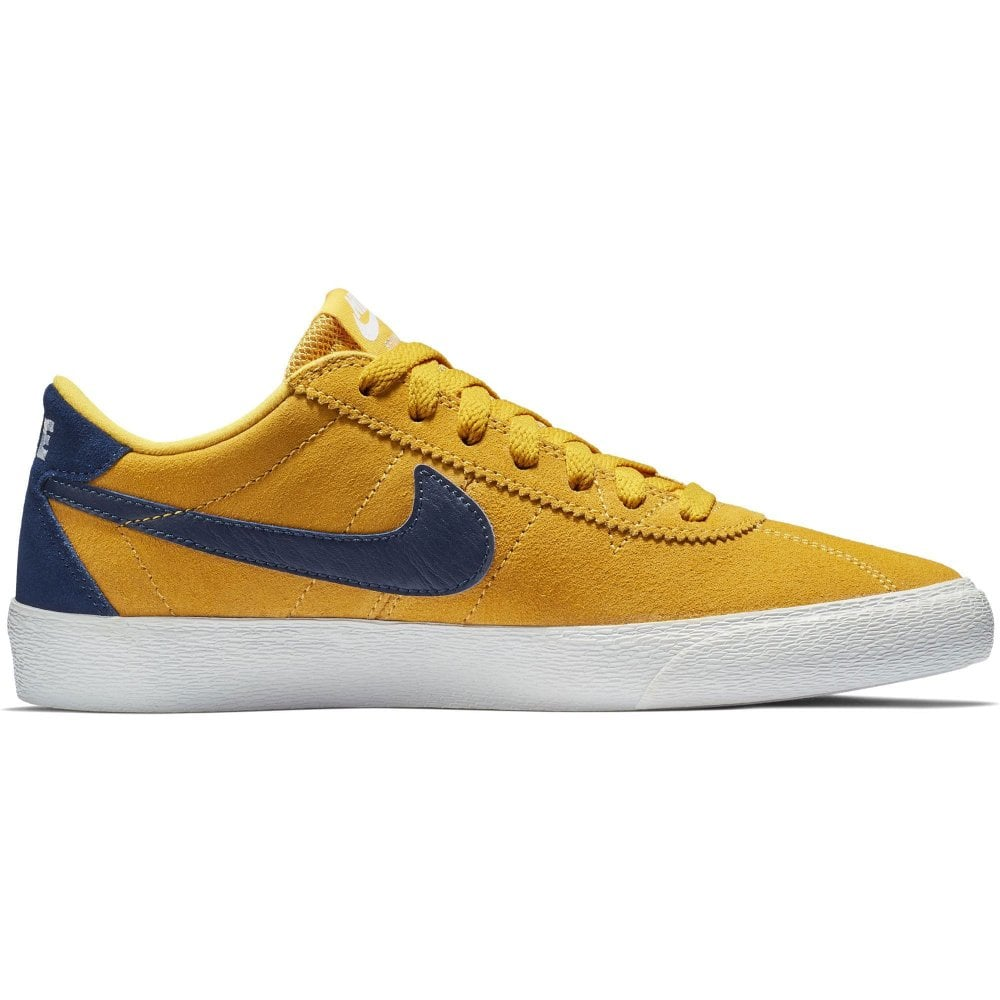 341766b53afb Nike SB Bruin Low Women s Shoe - Yellow Ochre Blue Void White